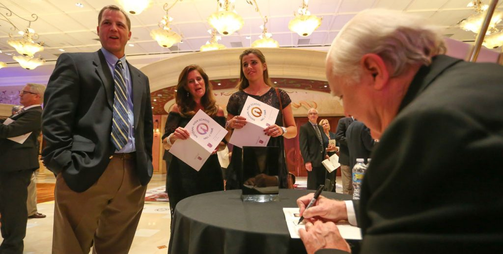 Dr. Proctor signs autographs following the induction ceremomy. Photo by Keith Warren