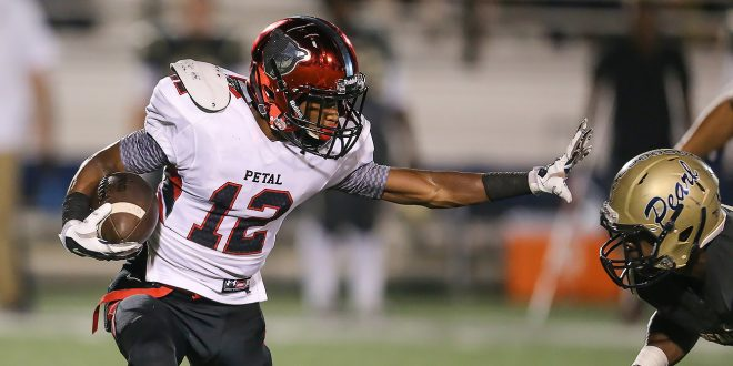 Petal's Joseph Peters (12) fights off a Pearl defender on a punt return. Pearl and Petal played in a Class 6A football game on Friday, Sept. 23, 2016. Photo by Keith Warren